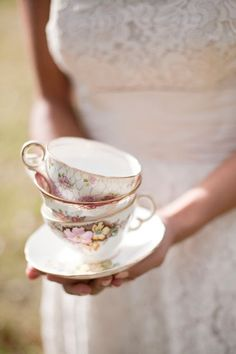 Stacked floral-patterned teacups... I officially qualify for old-lady status