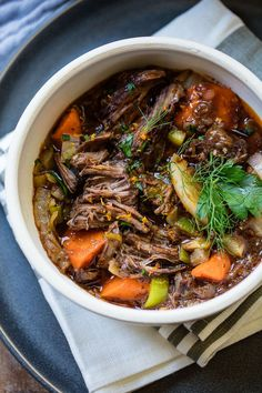 French-style slow cooker tender beef stew with red wine, Provencal herbs and vegetables.