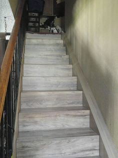 2 boxes later of Home Depot Wood Laminate flooring and our stairs are enclos Black Staircase, Luxury Staircase, Winding Staircase, Staircase Design, Big Design, House Design, Old Basement, Open Stairs, Traditional Staircase
