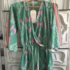 Elan Silk Romper- Amazing Colors & Brand New! Super beautiful combination of colors. Perfect for warm weather and very sexy for a night out with heels or can be converted to causal wear with summer flats/sandals. New with Tags. The size Large interprets into it best fitting a girl that's size (6-8) woman. Elan Pants Jumpsuits & Rompers