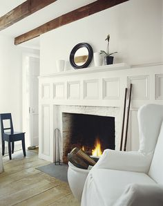 A modern white that is both cozy and clean, Tibetan Jasmine from Ralph Lauren Paint's Whitewash Palette warms a farmhouse living room.
