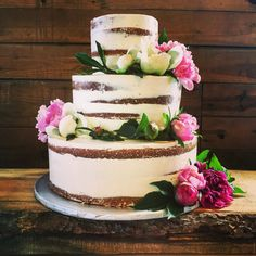 Rustic semi naked wedding cake with peonies.