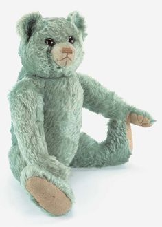 A rare turquoise mohair Farnell teddy bear  with brown and black glass eyes, pronounced clipped muzzle, brown stitched nose and hump 21¾in. (55cm.) high, late 1920's.