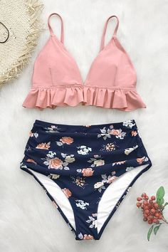 3bcb5a3bed Our Pink and Floral Ruffled High-Waisted Bikini set features a pink bikini  top with adjustable shoulder straps and ruffles under the bust.