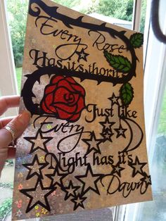 Original hand drawn and computer generated papercut by NIna Byers. Features the lyrics 'Every Rose has it's thorn, just like every night has it's dawn' B Poison. The lyrics are copyrighted, this was a gift to my sister.