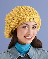 Combine popcorn stitches with a beret for a unique and stylish hat. (Lion Brand Yarn)
