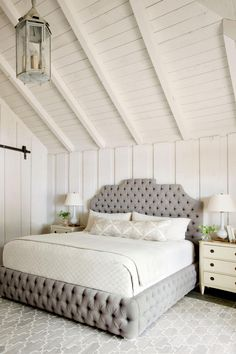 Create a Calm Master Suite | These lake house decorating ideas will help create a serene oasis, expertly blending with the beauty of nature all around. There's something so nostalgic about lake houses—memories of hot summers spent by the lake, autumn getaways to see the rich fall foliage. Lake houses are the de facto settings for big family gatherings, girlfriend getaways, and celebratory weekends. So shouldn't a lake house be a place that draws people in, wraps them up, and invites them to…