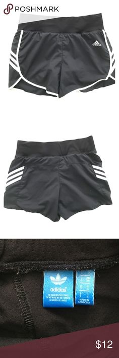 Adidas shorts Black with white stripes. Size small women's running shorts. These have spandex shorts inside adidas Shorts