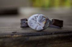 "A beautiful grand buckle of crazy lace agate is wrapped in a simple sheet of sterling silver enhancing a distressed strap of .50"" wide distressed leather. Buckle 1.50"" x 1.25""One of a kind, please advise length of your choice at checkout."