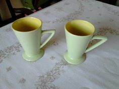 """Pair of retro style green and yellow mugs   Retro style mugs in a solid green color with a mustard yellow interior  Each mug is 4 5/8"""" (11.7 cm) high x 3 3/16"""" (8.1 cm) at the brim  These mugs are in near mint condition   03182015BIDB261Q"""