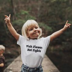 A cute free spirit in an adorable shirt. Oh what we can learn from the little ones of the world.