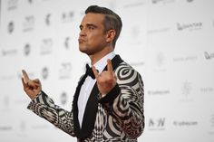 One item of clothing has been drawing all the attention this week, and that's Robbie Williams' positively psychedelic jacket from the 2016 ARIA awards. Love it or hate it, you've got to admit that Williams is no man to shy away from bending the rules of red carpet style. And while we often see our fair share of risqué gowns on women, Williams isn't the only man to push the boundaries of menswear. Tommy Hilfiger thinks designers should be proud to dress Melania Trump What every good father…