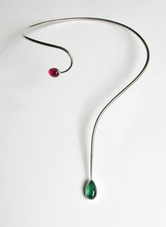 An original design this handmade neckpiece features two rare stones, a pink and green tourmaline.    The green tourmaline measures 15 by 10 mm and the pink tourmaline 9 by 8 mm.  The entire length measures 43cm, will fit up to neck size 35cm. This necklace is one of a kind and designed and made by Natasha Heaslip, a Galway (Ireland) goldsmith.    Items are posted with An Post using registered post.  You will be sent a tracking number once the item has been posted.  Delivery times can vary…
