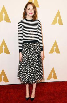 Emma Stone in a feminine ensemble: striped sequin long sleeve, polka dot midi skirt, and point-toe pumps