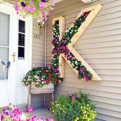 DIY Cedar Monogram Planter in Full Bloom by ElleryDesigns.com