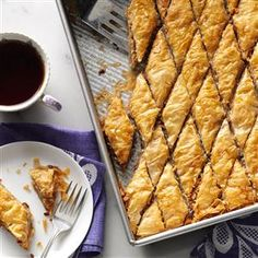 Double Nut Baklava Recipe -It may take some time to make this rich, buttery treat, but it's well worth the effort! The blend of coconut, pecans and macadamia nuts is irresistible. —Kari Caven, Coeur d'Alene, Idaho
