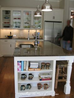 Kitchen island with bookshelf and bar - This view looks like my kitchen shape - would absolutely love this!