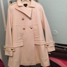 Cream empire waist coat xs VIA Victoria's Secret OFF WHITE/cream wool coat with gold buttons. Empire waist swing coat. Has side and front pockets. NWT. Size xs Jackets & Coats