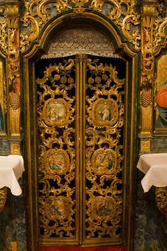 Baroque door in the richly decorated altar of the wooden church of Jedlinka (Jedlinka, Slovakia)