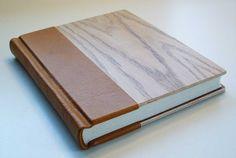 Elegant handmade book, traditionally bound, hand-sewn, in warm oak wood and brown calfskin. Journal, sketchbook, diary.