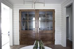 Heather A. Wilson's new build of classic bungalow in Charleston, South Carolina, interior white wood siding, Remodelista
