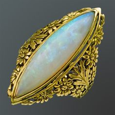 ART NOUVEAU  Superb Floral Ring   Gold Opal. European, c.1900  The marquise precious opal 8 cts approx