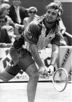 Andre Agassi. Are you wondering what is awesome? Jean shorts, spandex and a mullet. Yes!