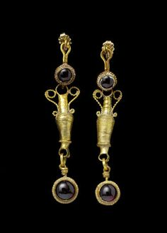 A pair of Hellenistic gold and garnet earrings  Circa 2nd-1st Century B.C.
