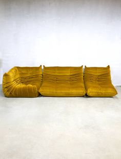 This iconic Togo was produced by Ligne Roset and designed by Michel Ducaroy. It was reupholstered in a yellowgold velour fabric. This Togo consists of 3 seat elements. Nomadic Furniture, Weird Furniture, Home Furniture, Furniture Design, Retro Interior Design, Amsterdam Houses, Ligne Roset, Loft Interiors, French Home Decor
