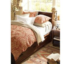 I have this bedding... Any ideas of wall paint color? The room gets great light and it pretty big.