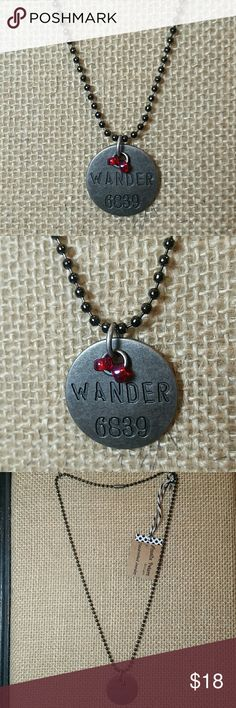 "Amalie Peters Ball Chain Dog Tag Charm Necklace This is for a brand new, beautiful necklace by Amalie Peters Designs. It is a gun metal silver ball chain with a circle dog tag charm. The charm says ""Wander"" and has 2 magenta pink seed beads for a cute detail. Stamped with numbers. I have this necklace with many words and other colors. Made in the USA with quality materials. Can change the seed bead color to any other color. This style necklace was donated by Amalie Peters Designs to girls in…"