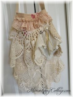 The Victorian Gypsy boho slouchy handbag. Acts in the same way as stylistic qualities from the Victorian era like ruffles and layers around the neck and on the sleeves. Gives the ideas of a lace handkerchief.