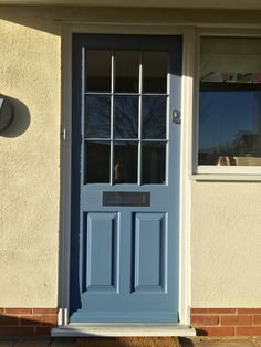 Timber Entrance Door painted RAL 5014, fitted with contemporary stainless steel ironmongery
