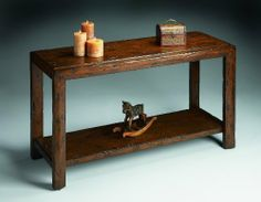 Butler Console Table Mountain Lodge - 7063120 by Butler. $529.00. Rustic console crafted from Gemelina solids and Wood products. 48 in. W x 18 in. D x 30.25 in. H (55 lbs.). Features a heavily distressed, undulated surface finish with in a Warm Brown Patina. Mountain Lodge finish. 7063120 Features: -Rustic style.-Heavily distressed, undulated surface with in a warm brown patina. Construction: -Constructed of gemelina solid wood. Collection: -Mountain Lodge collection.