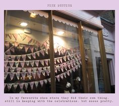Pretty bunting/pennants in a store window.