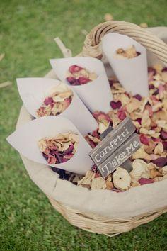 choose natural dried delphinium petals or colored rose petals as confetti