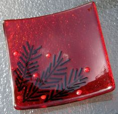 Beautiful transparent red dish with dark green pine tree needles and little red berries. A cute little dish that will add color to any room.
