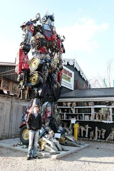 I really want to take the boys to see this. Optimus Prime made from real car parts.