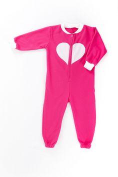 Pink onesie with GLOW in the DARK heart. Onesie + GLOW in the DARK = GLOWSIE = endless amount of fun for children.