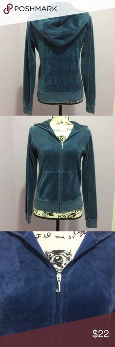 """Juicy Couture Hoodie A beautiful shade of blue, silver tone hardware  zip up hoodie. A soft velour feel with a subtle blue graphic with skeleton key. Says """"House of Juicy"""" P-P 18"""" S-H 22"""" Sleeve 25"""" W 16 1/2"""" Juicy Couture Tops Sweatshirts & Hoodies"""
