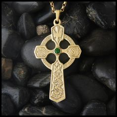 Large Celtic Trinity Cross in Gold shown with a Tsavorite Garnet.