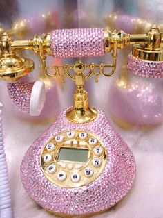 Old school pink bejeweled telephone.