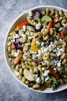 Bright and flavorful roasted veggie mediterranean pasta with goat cheese is the perfect vegetarian meal! It's packed with fresh veggies, tossed in a delicious cashew pesto sauce, and makes incredible leftovers.