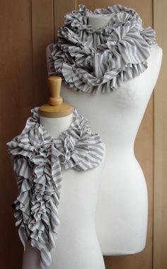 Ruffle scarves, diggin' the stripe. I think this one was made using a wide and a narrow piece and then stitching them together after ruffling