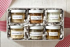 The most basic of seasonings turns truly gift-worthy when you incorporate wild mushrooms, ancho chilies, or garam masala—then arrange it all in adorable jars sporting our typewriter-style labels. A sleek metal tin completes the set. (Labels formatted to fit an 8½''W x 11''L sheet of sticker paper)     Bright idea: Shred old newspapers or book pages for inexpensive, earth-friendly packing materials.      Recipe: Flavored Salts (Plastic jars, $1.49 each; 2 oz.; containerstore.com. Tin, $3.99…