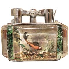 A Fine Alfred  Dunhill Reversed Carved and Painted Aquarium Lighter 1950 | From a unique collection of antique and modern tobacco accessories at http://www.1stdibs.com/furniture/more-furniture-collectibles/tobacco-accessories/