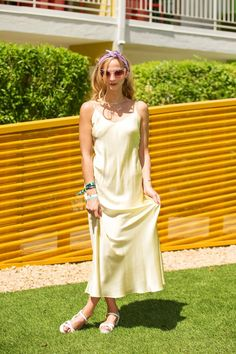 40+ Coachella Street Style Looks That Bring The Heat #refinery29  http://www.refinery29.com/2015/04/85205/coachella-2015-street-style-pictures#slide-14  Annie Georgia Greenberg in a vintage lemon-yellow slip dress and a practical lavender hair scarf.
