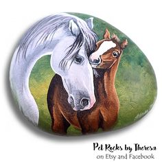 Horses painted on rock by artist Pet Rocks by Theresa on Facebook and Etsy