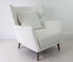 Crisp curves, elegant white faux leather. This Wing Occasional Armchair is perfect any living or bedroom interior.