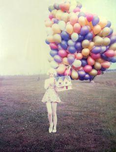 Little girl. Bog Balloons. Lovely washed out polaroid feeling.